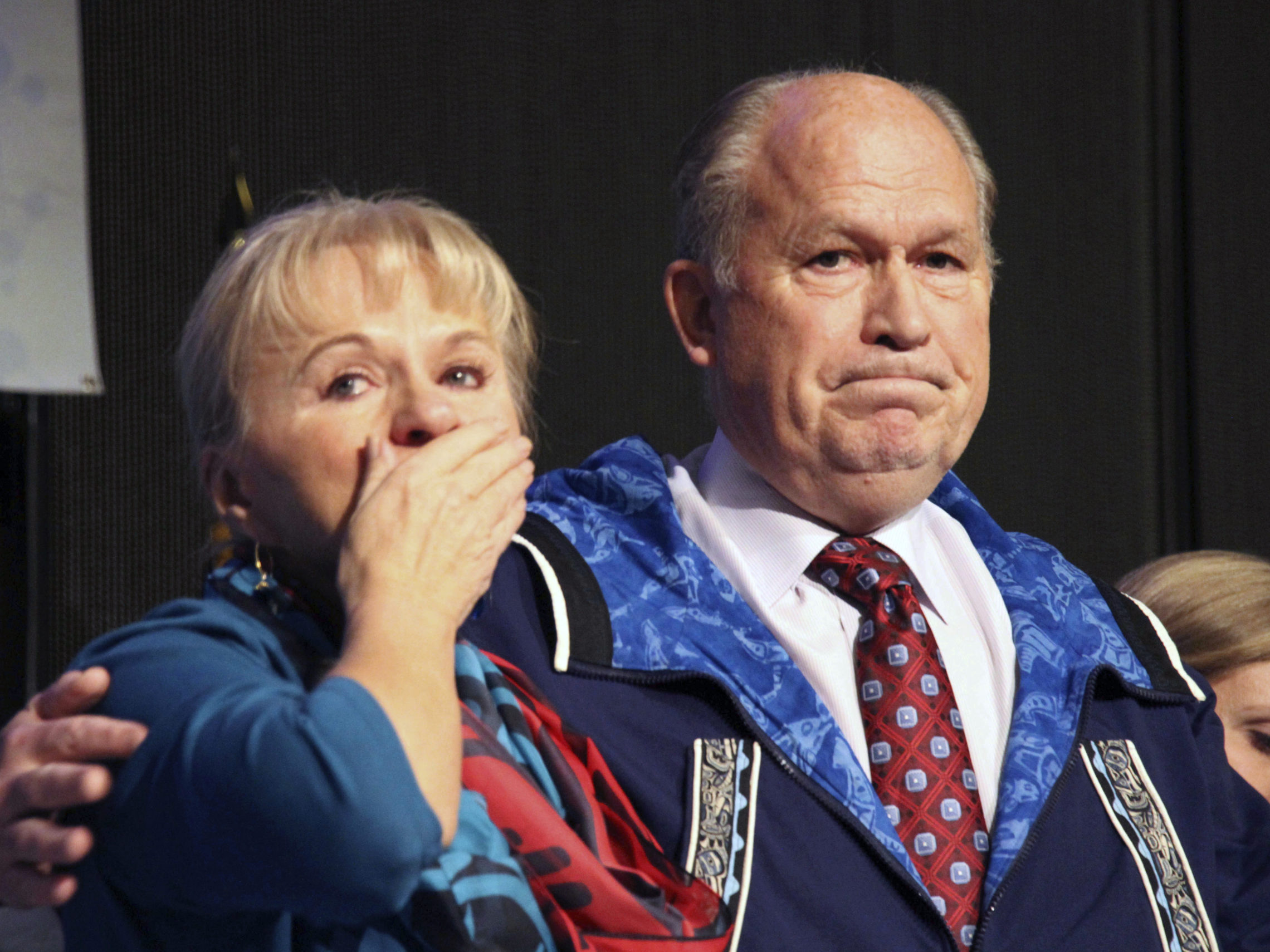 Donna Walker blows kisses to the crowd as her husband, Gov. Bill Walker, announced he was suspending his re-election bid and supporting Democrat Mark Begich. He has been far behind in the polls, and his lieutenant governor resigned for an