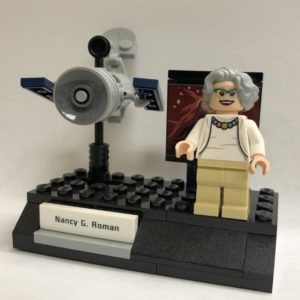 Lego honored Astronomer Nancy Grace Roman by including her figurine, shown next to the Hubble Space Telescope, in a set of groundbreaking NASA women. Russell Lewis/NPR