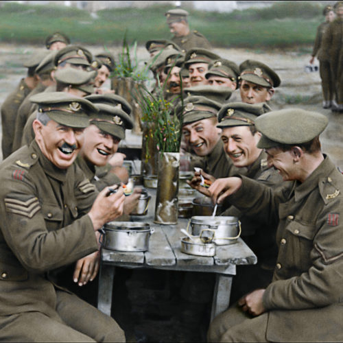 Peter Jackson restores archival footage of British soldiers enjoying a meal in the documentary They Shall Not Grow Old. Warner Bros. Pictures