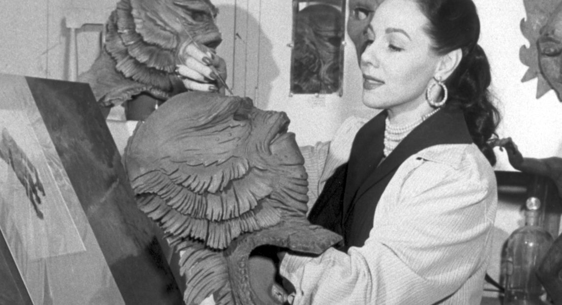 Milicent Patrick poses in the Universal Studios monster shop with her most famous creation: the Creature from the Black Lagoon. Family collection/Courtesy of Hanover Square Press