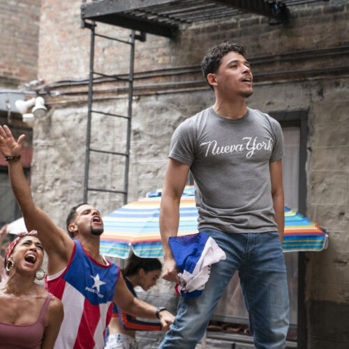 Usnavi (Anthony Ramos) runs a corner bodega and dreams of returning to the Dominican Republic in In the Heights. Courtesy of Warner Bros. Pictures